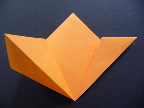 7. Unfold and open up one side. Flatten and crease well.